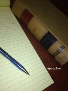 Legal Pad, pen and law book